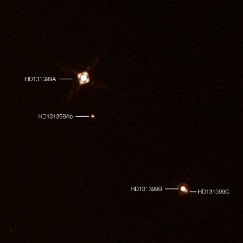 This annotated composite image shows the newly discovered exoplanet HD 131399Ab in the triple-star system HD 131399. The image of the planet was obtained with the SPHERE imager on the ESO Very Large Telescope in Chile. This is the first exoplanet to be discovered by SPHERE and one of very few directly-imaged planets. With a temperature of around 580 degrees Celsius and an estimated mass of four Jupiter masses, it is also one of the coldest and least massive directly-imaged exoplanets. This picture was created from two separate SPHERE observations: one to image the three stars and one to detect the faint planet. The planet appears vastly brighter in this image than in would in reality in comparison to the stars.