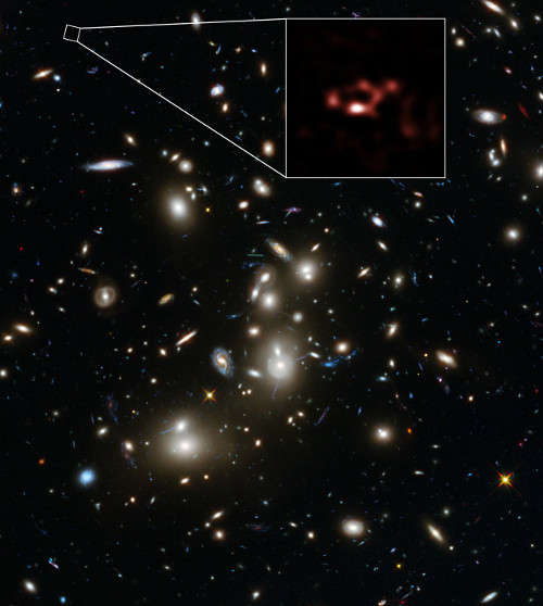 This image is dominated by a spectacular view of the rich galaxy cluster Abell 2744 from the NASA/ESA Hubble Space Telescope. But, far beyond this cluster, and seen when the Universe was only about 600 million years old, is a very faint galaxy called A2744_YD4. New observations of this galaxy with ALMA, shown in red, have demonstrated that it is rich in dust.