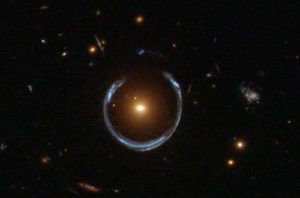 materia oscura y lentes gravitatorias